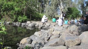students in field trip next to stream